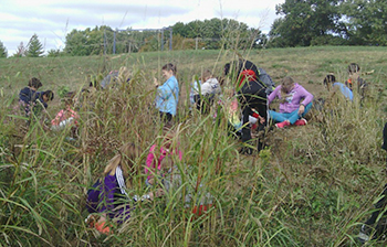 Students together in a prairie on a work day